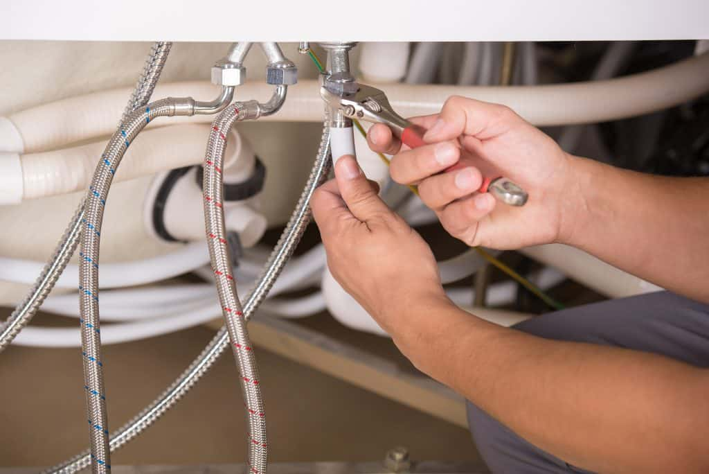 stock image plumber wrenching